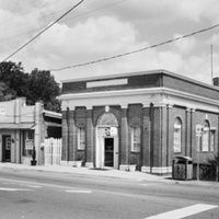Former Farmers and Merchants Bank at left and former Bank of Louisa, now town offices, at right on East 1st Street (Mineral, Louisa County)