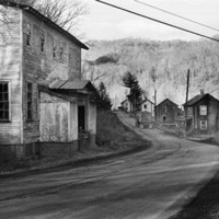 Coal truck passing former African American school and houses (now gone) on Stonega Road en route to the mines (Stonega, Wise County)